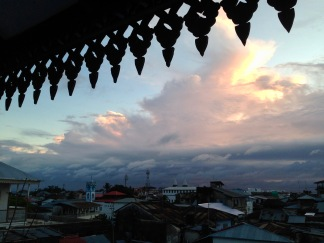 A rooftop view of Stone Town's minarets during the sunset call to prayer.